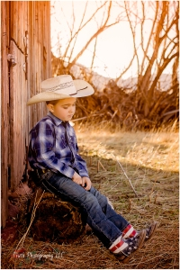 Boulder child photographer, cowboy at barn