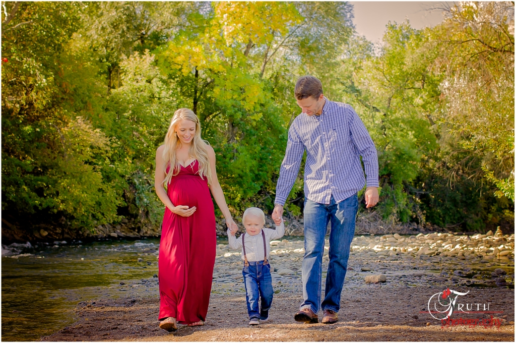 Golden Co. Maternity photographer, maternity portrait family walking by river